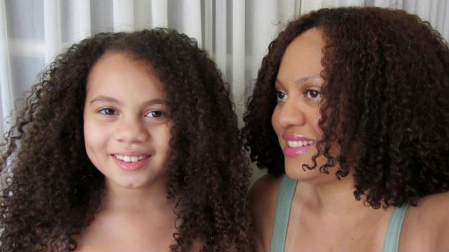 curly mom and daughter