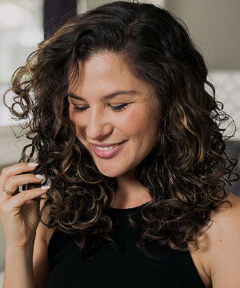 How Curlies & Wavies Are Using Oil as a Styler