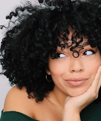 25 Photos That Will Make You Want Curly Bangs