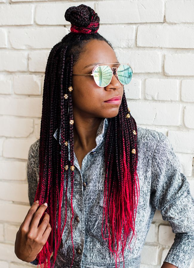 Gerilyn with red box braids and sunglasses