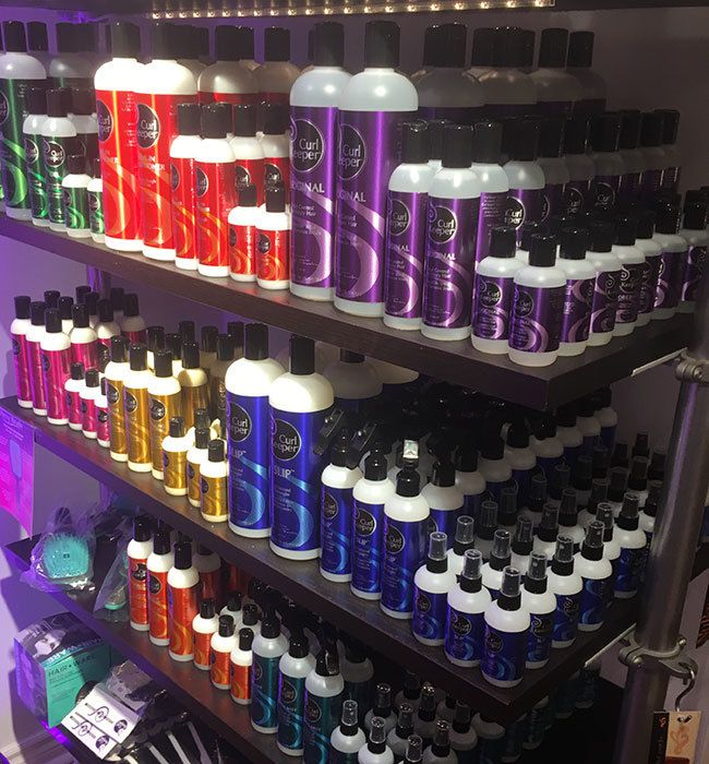 curly hair solutions products on a shelf in the salon