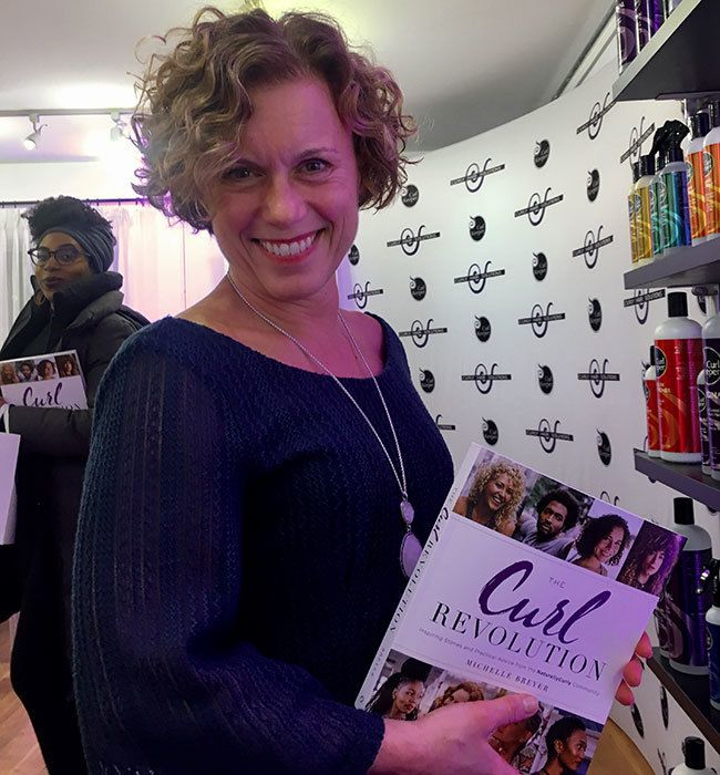 attendee with the curl revolution book