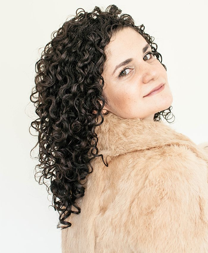 Curly hair woman wearing a fur coat