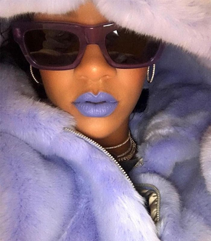Rihanna with sunglasses and fur coat