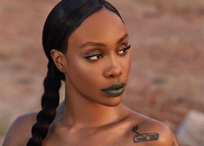 Singer Sza wearing green lipstick from Fenty Beauty