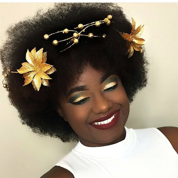 African-American woman wearings gold flowers in her afro