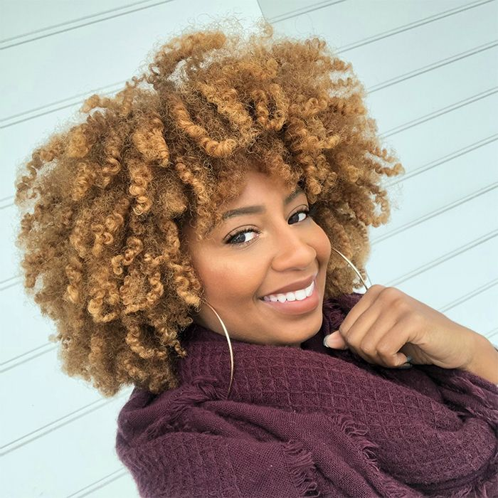 African-American women with copper curly hair