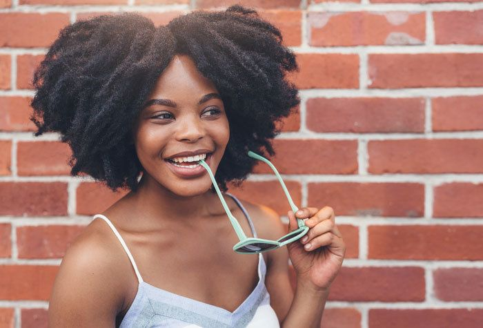 woman with coily natural hair