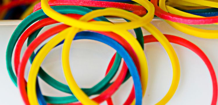 A picture of multi colored rubber bands piled together