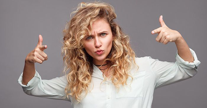 Blonde girl making gestures at camera photo by maxkegfire for istock