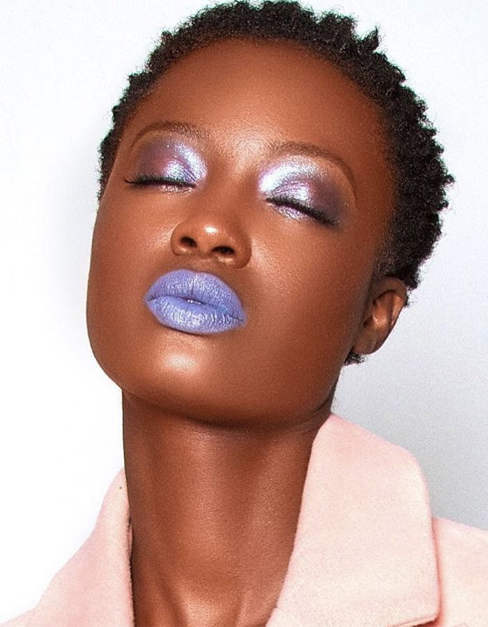 African-American women with short hair wearing purple makeup