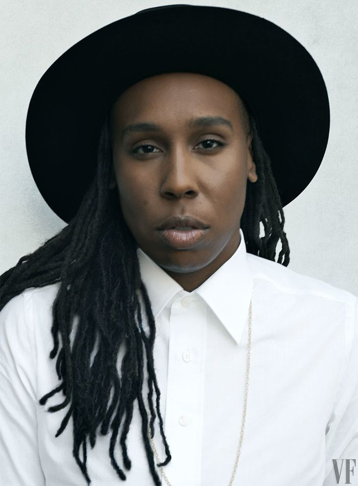 Lena Waithe wearing a black hat and white button down shirt for Vanity Affair
