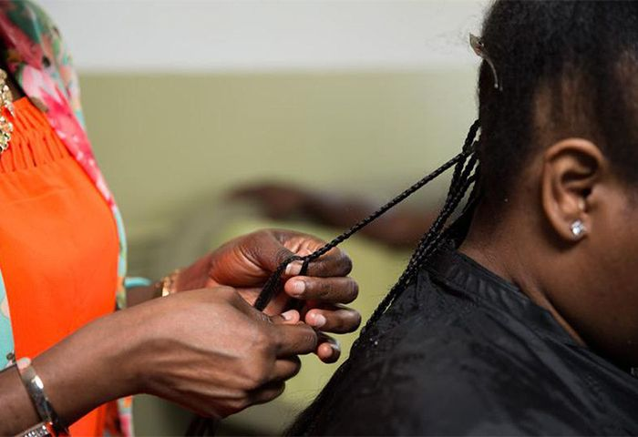 Woman braiding hair