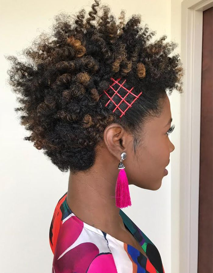 African-American woman with curly hair and pink bobby pins