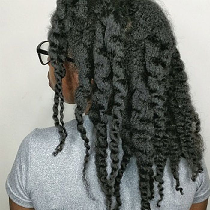 African-American woman with natural hair twisted