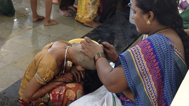 indian woman shaving head