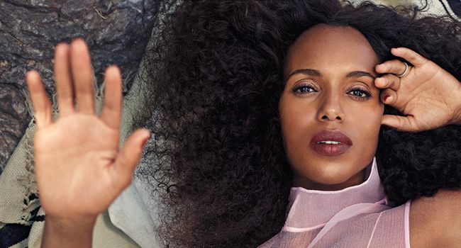 Kerry Washington laying down with her hand up