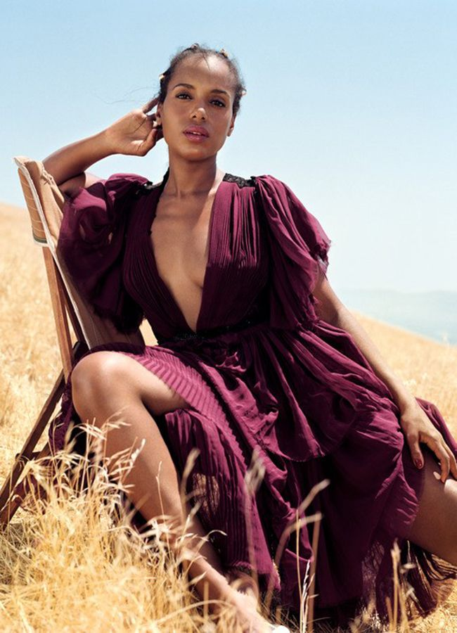 Kerry Washington in a purple dress posing on a chair