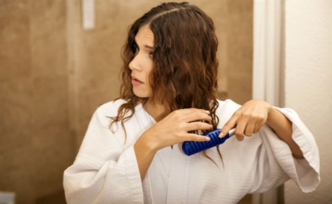 breaking hair with brush
