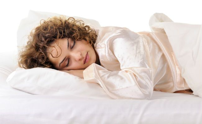 woman sleeping with curly hair