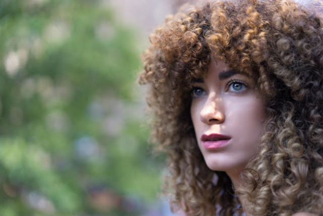 woman with curly bangs