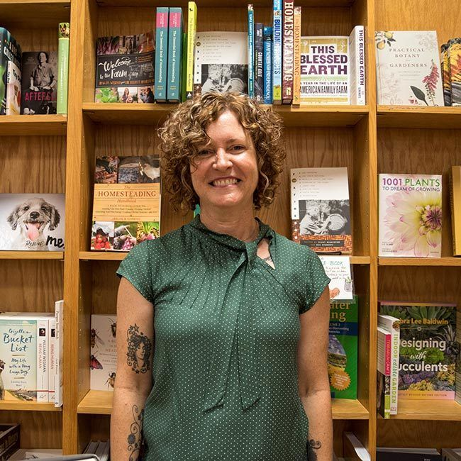 Local artist Suzzane Schroeder photographed b y Amy Weiss Photography inside BookPeople for The Curl Revolution book signing.