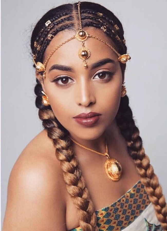 Woman with head piece and braids