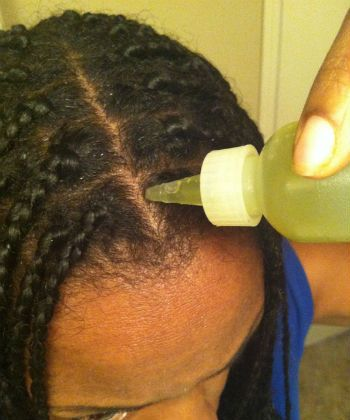 applying oils to the scalp