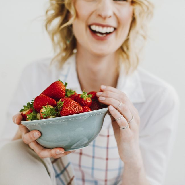 wavy hair woman with strawberries
