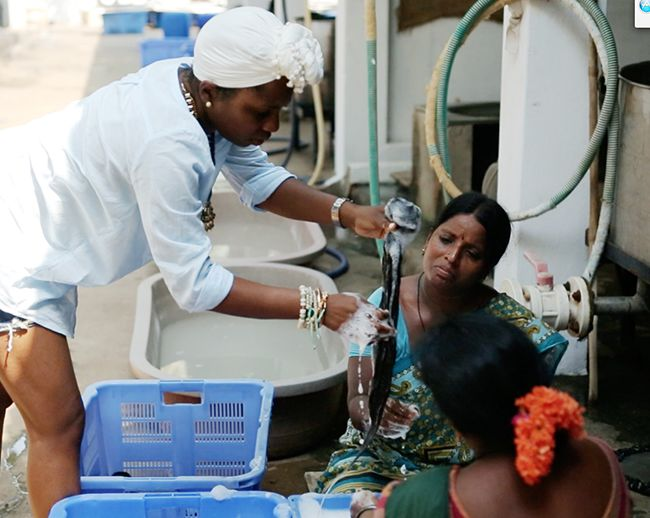 indian woman washing hair extensions