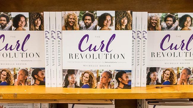 Copies of The Curl Revolution by Michelle Breyer sit on retail shelves at BookPeople in Austin, TX.