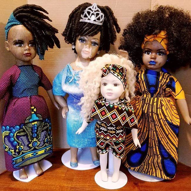 vitiligo dolls in a group