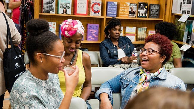 Young women with curly hair styles enjoy themselves at BookPeople.