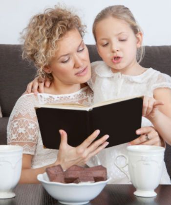 mom and daughter enjoy tea and books