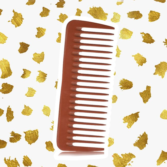 A brown wide-tooth Nubone comb