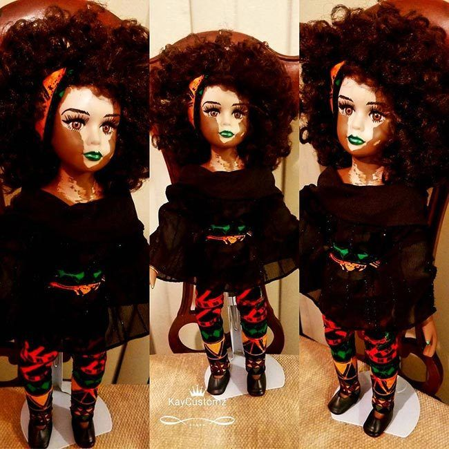 Vitiligo doll with Africa on face