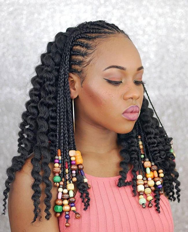 Woman looking down with braids with multi-colored beads