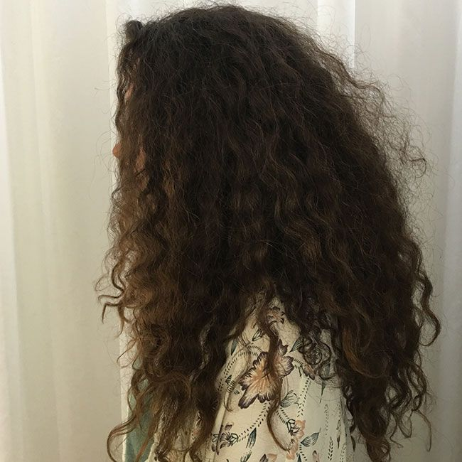side view before long curly haircut