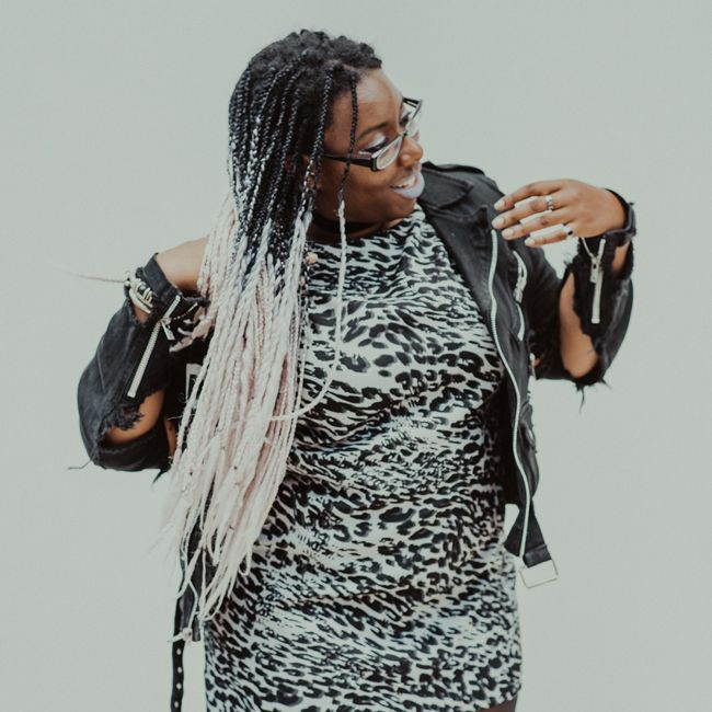 Editor April B swishes black and pink box braids over her shoulder