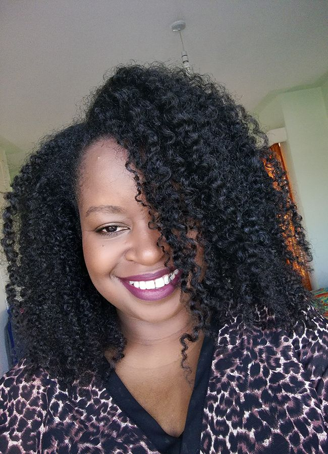 kenya girl smiling with natural hair