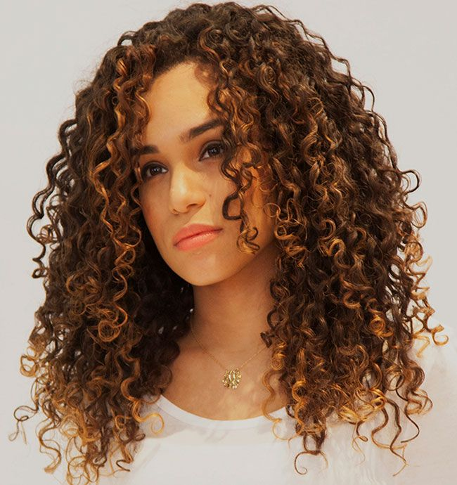 Long naturally curly hairstyles with side bangs