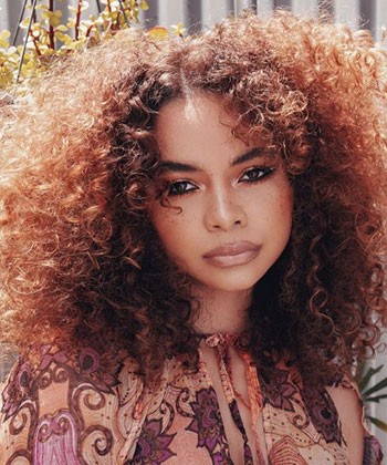 18 Curly Copper Hair Goals That'll Jump Start Your New Summer Look