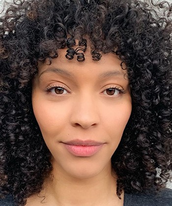 How to Cut and Style Curly Bangs, According to a Stylist