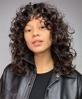 18 Ways to Rock Curtain Bangs on Curly Hair