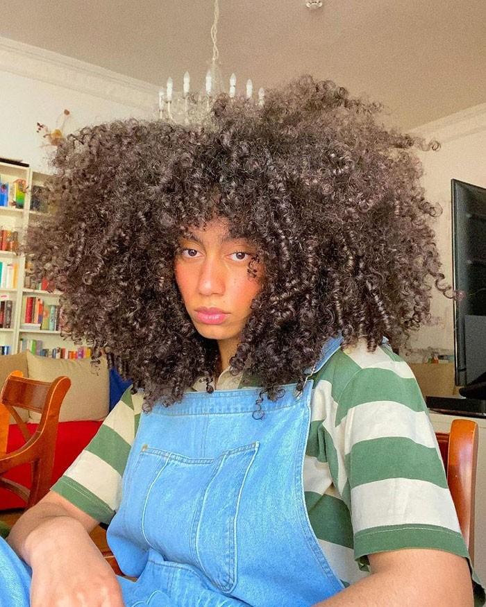 nisa-curly-curtain-bangs