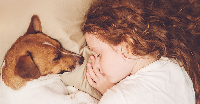 sleeping child with red curly hair