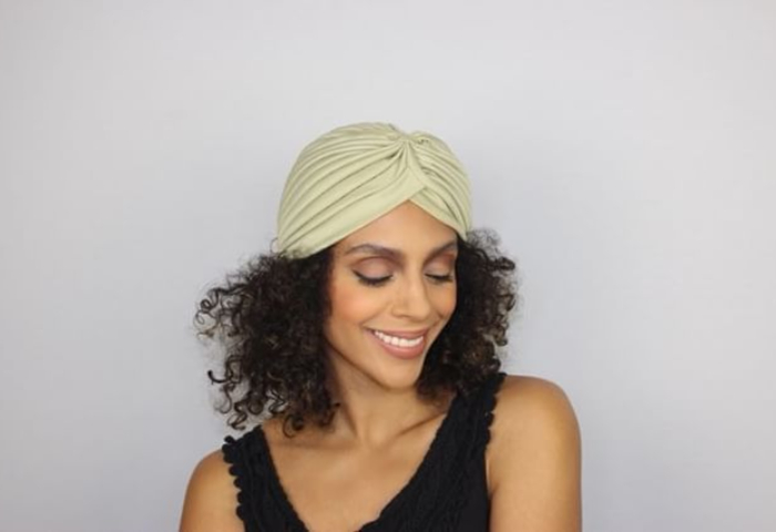 woman with natural hair wearing beiege turban