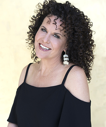 Texture Tales: NaturallyCurly Co-Founder Michelle Breyer Shares Her Love Story with Her Curls