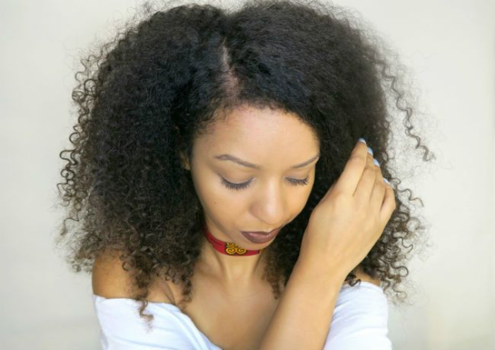 woman with natural 3c curls down in a middle part