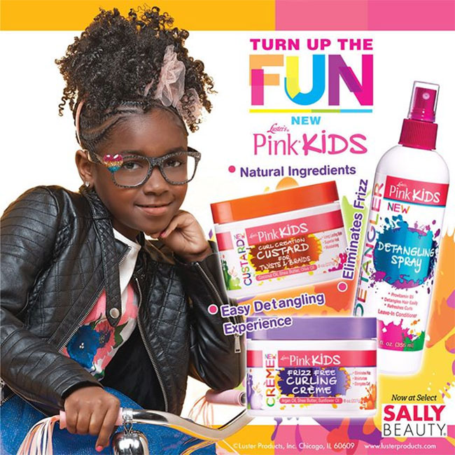 child with curly hair posed with luster pink kids products